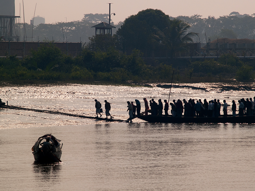 People disembarking from a ferry boat in Bangladesh