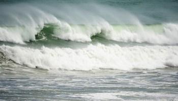 Waves crash ashore during a storm