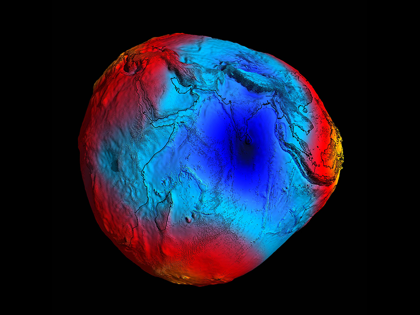 """A large """"dent"""" in Earth's geoid in the Indian Ocean indicates that less mass is concentrated here than is typical."""