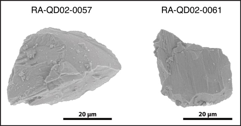 Two grains of Itokawa surface material analyzed for its water composition