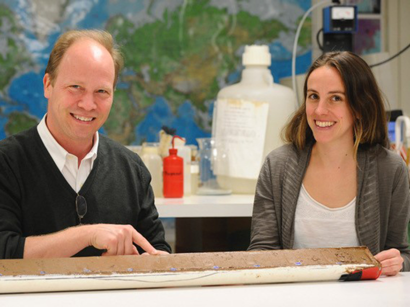 Scientists point out red Saharan dust in a sediment core drilled from the Atlantic Ocean floor off West Africa.