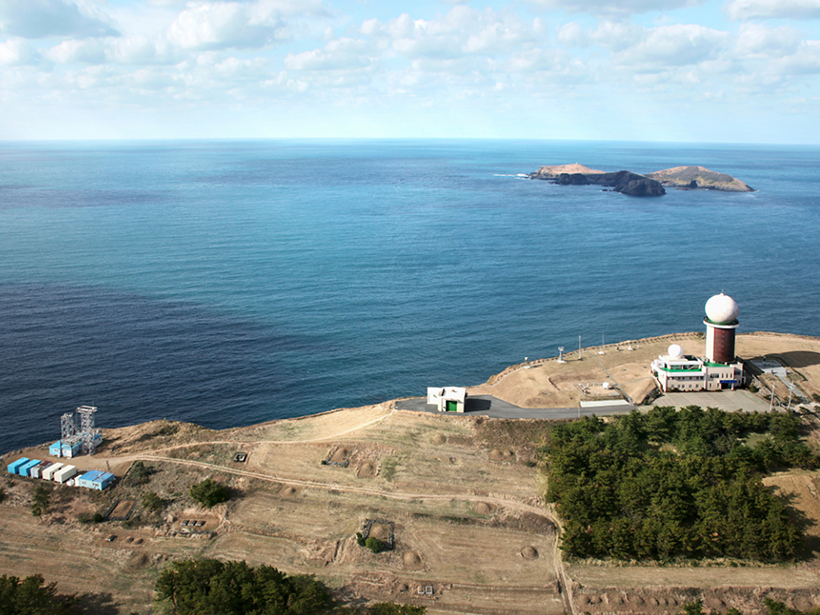 Aerial photo of a scientific facility on the coast
