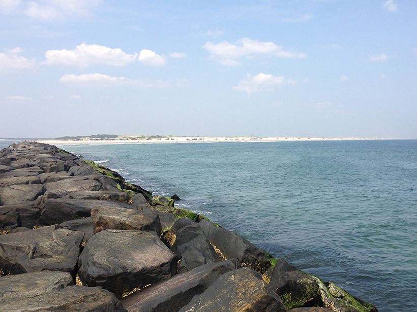 Photo of a jetty and ocean beach