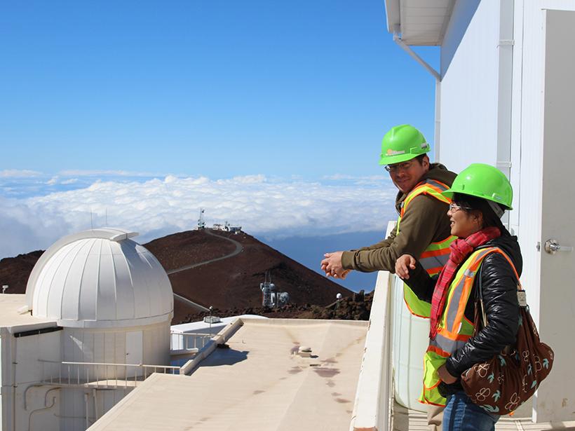 Photograph of scientists Stacey Sueoka and David Harrington at the new Daniel K. Inouye Solar Telescope.
