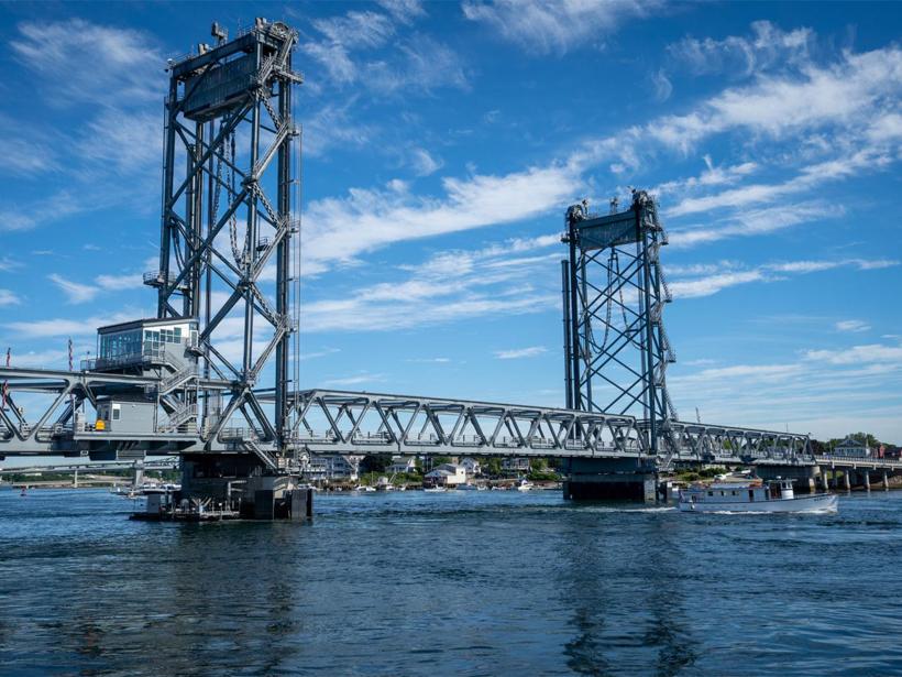 A vertical-lift bridge spanning a river