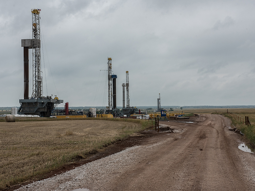 Photo of fracking rigs along a dirt road
