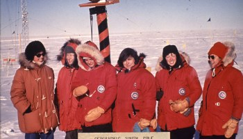 The first six women to reach the South Pole stand at the site in 1969
