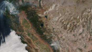 Satellite image of California with wildfire smoke dominating its northwest corner