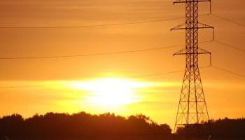 Sunrise over power transmission lines