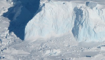 Aerial photo of the white and blue ice of the Thwaites ice shelf