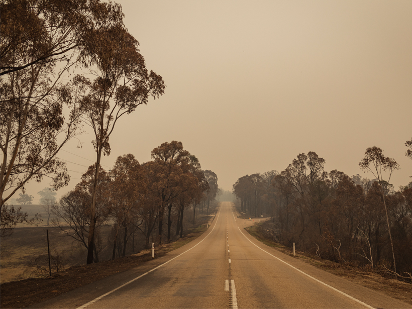 A road through a smoky landscape in Australia on 13 January 2020