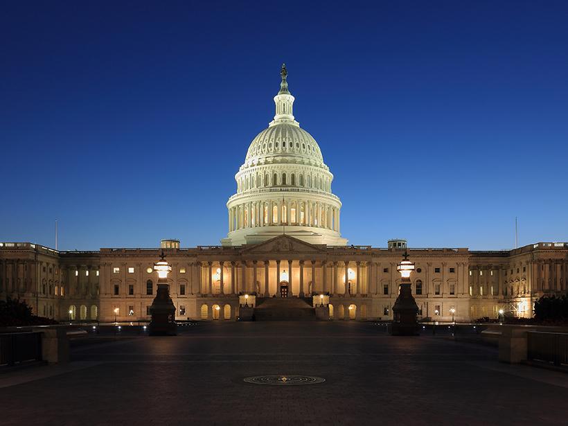Lit U.S. Capitol Building at dusk