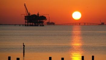 Drilling rig and Dauphin Island Bridge in Mobile Bay, Alabama