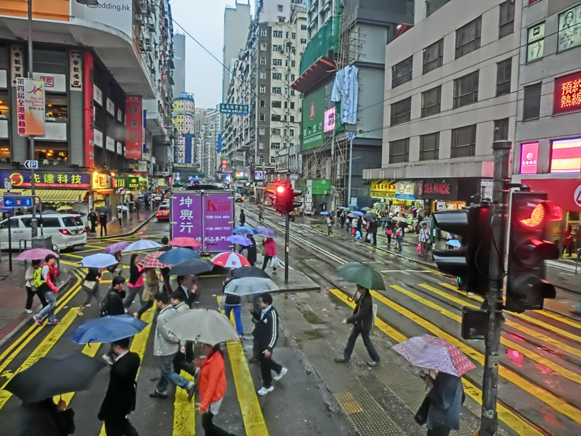 Elevated photo of a busy Hong Kong street during a light rain