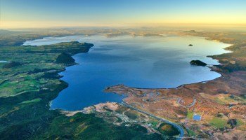 This aerial view shows Lake Taupō amid the whenua (land) of Ngāti Tūwharetoa on the North Island of New Zealand.
