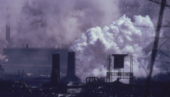 Photo of a coke plant belching white smoke and emissions