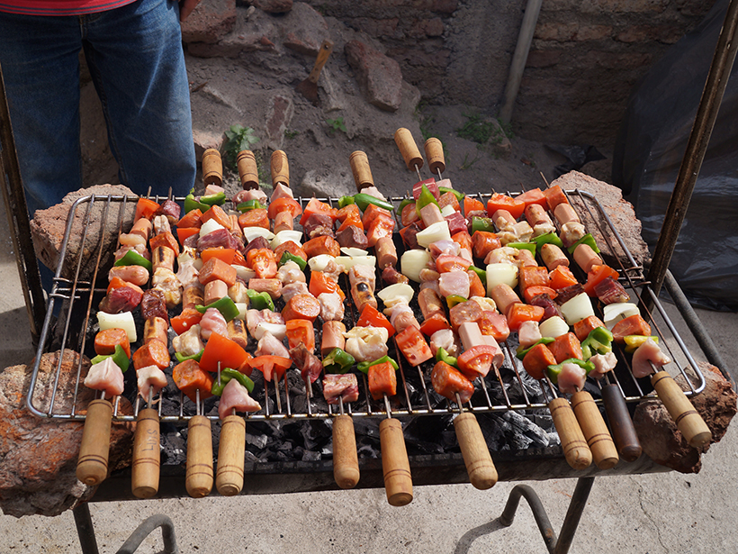 Skewered meat and vegetables on a barbecue