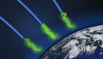 Illustration showing magnetic field lines carrying charged particles to Earth's ionosphere
