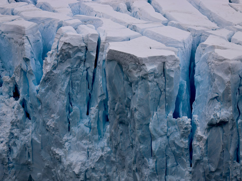 Enormous ice chunks about to calve from a glacier in Neko Harbor, Antarctica