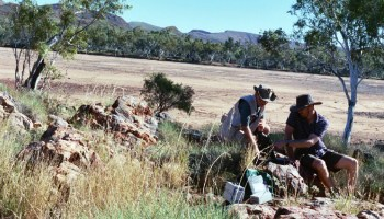 Scientists take spectrometric readings at a rock outcrop in Western Australia
