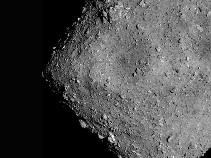 Black-and-white satellite image of the asteroid Ryugu