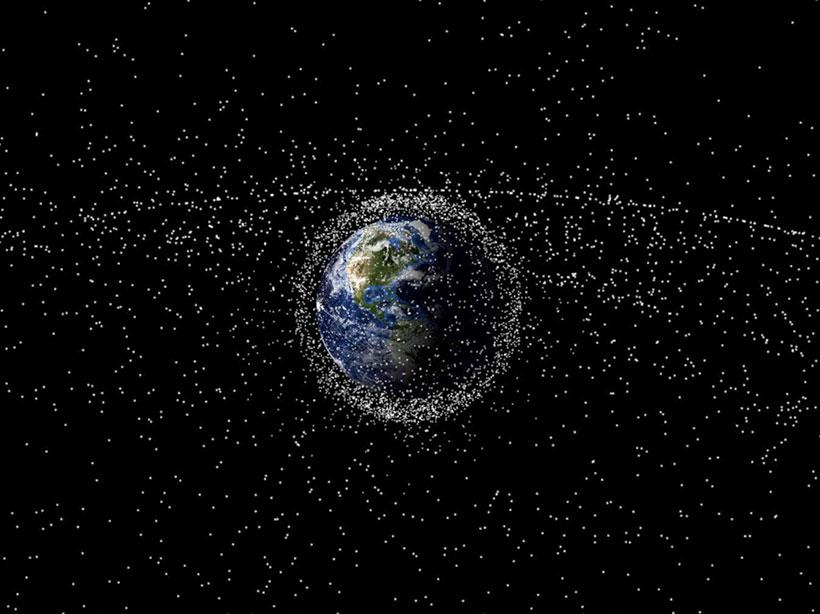 Globe with debris littering low Earth orbit