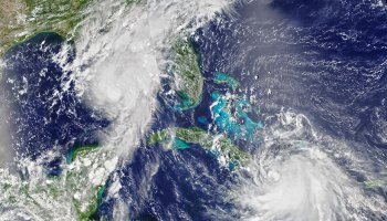 Satellite image of storms Marco and Laura in the western Caribbean and Gulf of Mexico