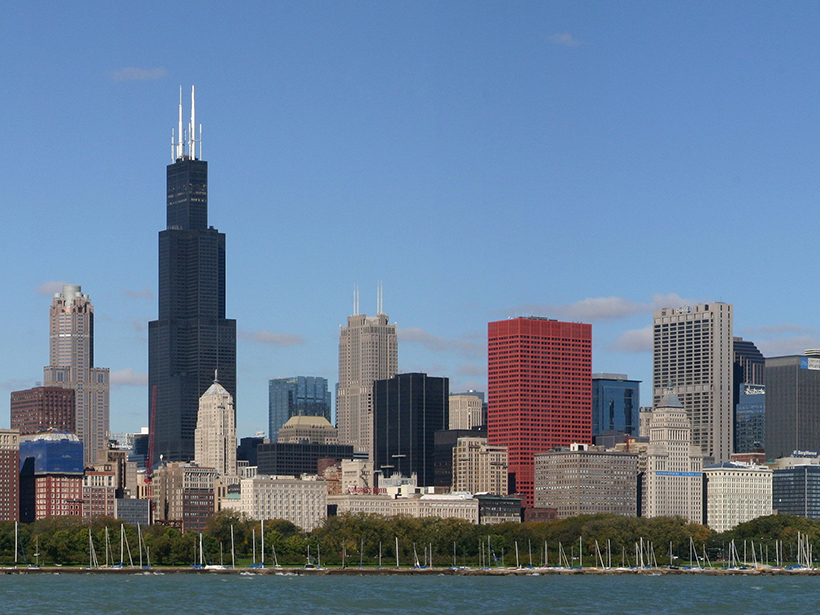 A partial view of the Chicago skyline seen from the water on a sunny day