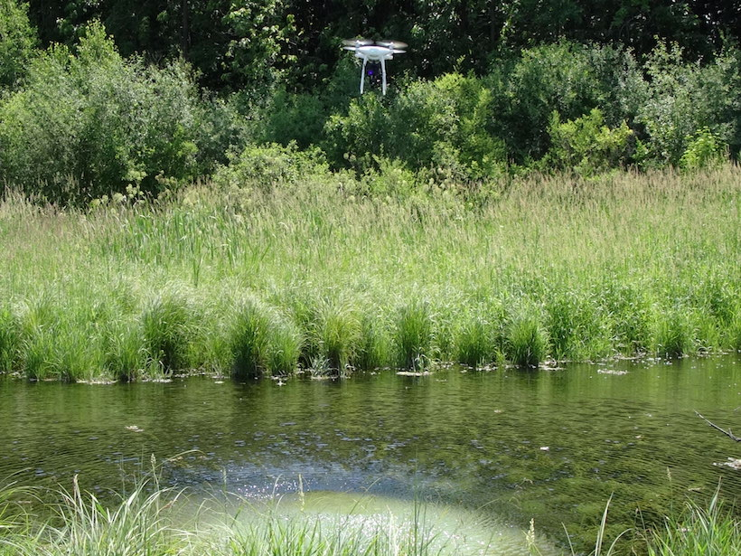 A drone hovers over a spring in Fitchburg, Wis.