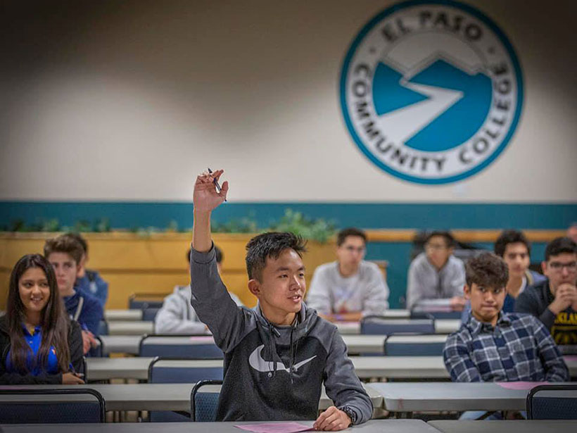 One student in an El Paso Community College lecture raises his hand.