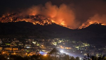 Fires burn at night on the hills of Tidbinbilla near Canberra, Australia, on 6 February 2020.