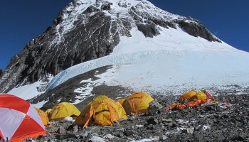 Tents below the snow-capped summit of Mount Everest