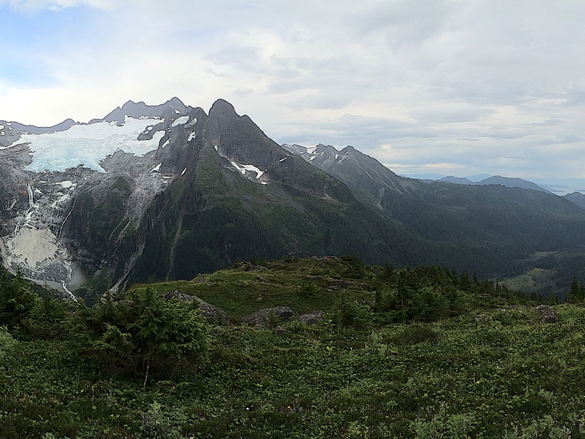 Landscape view showing mountains, forests, and other vegetation within the Héen Latinee Experimental Forest north of Juneau, Alaska