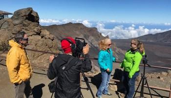 A film crew interviews a scientist in Haleakalā National Park, Maui, Hawaiʻi