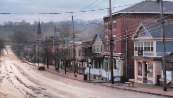 Shops line a street running through a small town in upstate New York.