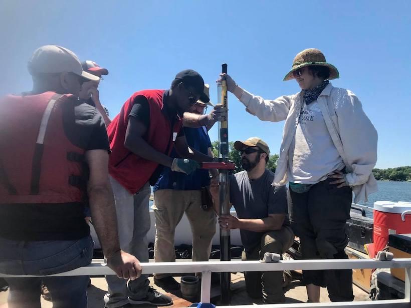 Paleolimnologist Tumaini Kamulali takes core samples on Sweeney Lake in Minnesota.