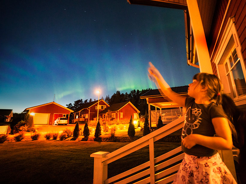 A girl pointing at the night sky