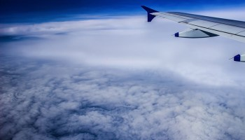 View from an airplane flying above a layer of clouds