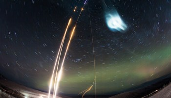 A composite picture of time-lapse images of the Super Soaker launches and resulting noctilucent cloud