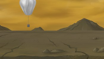 An artist's depiction of the surface of Venus with volcanoes in the background, clouds in an orange sky, and a silver scientific balloon hovering above a brown, rocky ground.