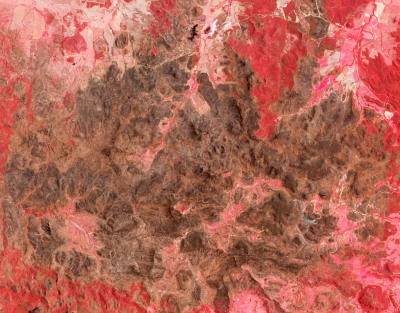 Satellite image of Siding Spring Observatory, Australia, surrounded by a burned landscape