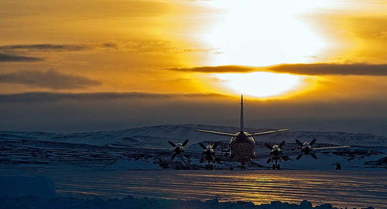 Photograph of aircraft on the ground at sunrise in Greenland