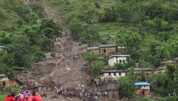 Debris from a large landslide is heaped amid a damaged community in western Nepal