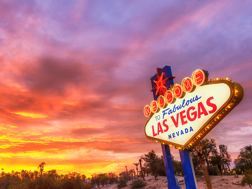 """""""Welcome to Fabulous Las Vegas"""" sign against a backdrop of desert flora"""