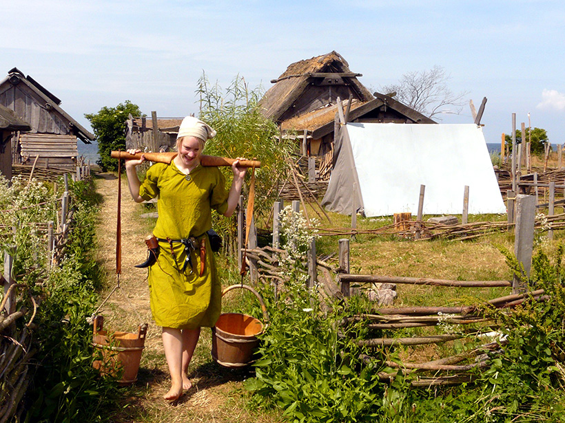 A reenactor works on a Viking farm at a living history museum in Sweden.