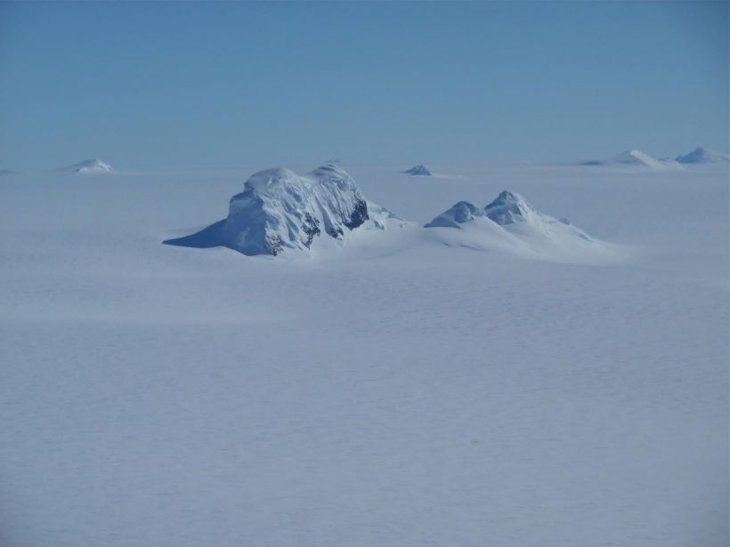 Mountain peaks through the ice cover on Thurston Island off of western Antarctica.