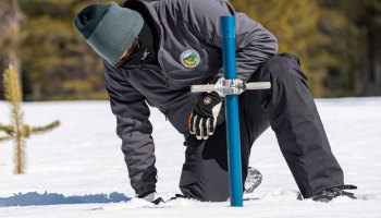 Image of Sean de Guzman of the California Department of Water Resources conducting a snow survey in the Sierra Nevada.