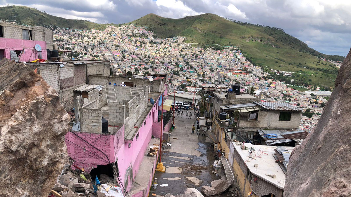 Debris covers a densely populated hillside community in Cerro del Chiquihuite, Mexico.