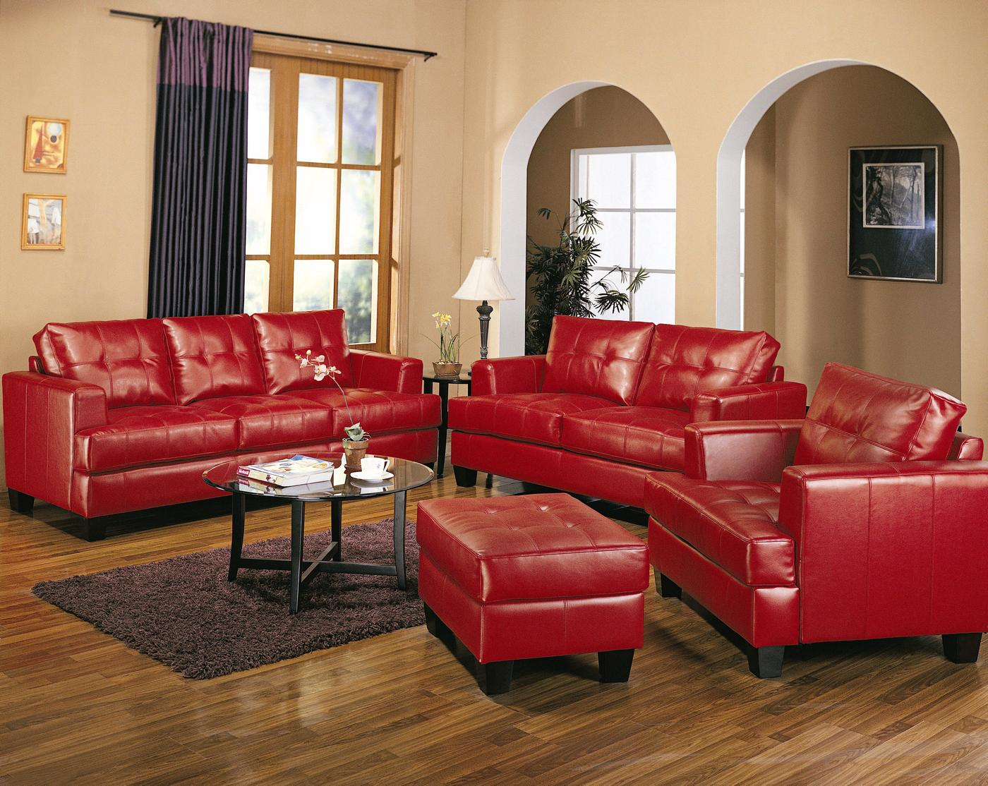 The leather sofa has long been a staple in thoughtfully curated homes, because, well, it does it all. Samuel Red Bonded Leather Sofa And Love Seat Living Room Set
