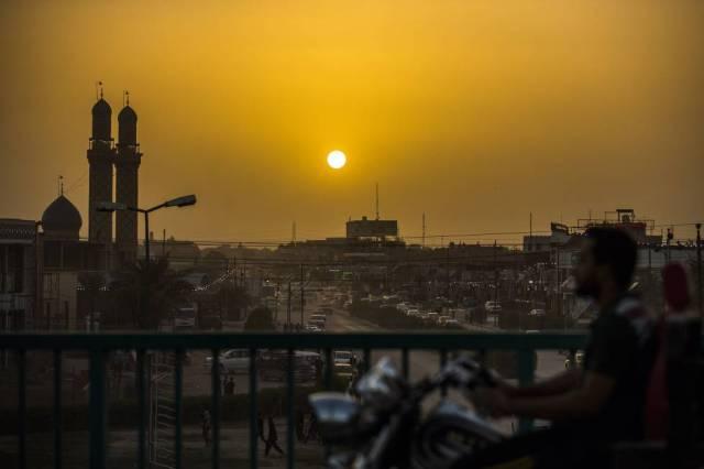 Amanece en Nayaf, la capital intelectual del chiismo. Al fondo, la mezquita de Alí.